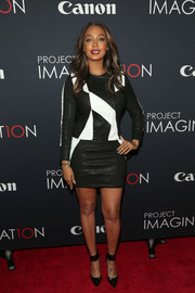 La La Anthony teamed black ankle-strap pumps by Gianvito Rossi with a leather mini dress for a fierce finish at the Project Imaginat10n Film Festival.