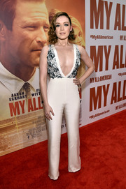 Sarah Bolger put on a sultry display at the premiere of 'My All American' in a white Thai Nguyen jumpsuit with a navel-grazing neckline and an embellished bodice.