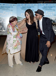 Angelina Jolie opted for a simple black maxi dress when she attended the premiere of 'Faces Places.'