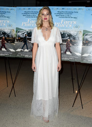 Jennifer Lawrence made us swoon when she wore this white lace gown by L. Wells Bridal to the premiere of 'Faces Places.'