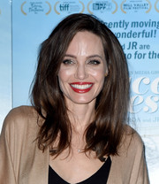 Angelina Jolie wore her hair loose and with lots of volume at the premiere of 'Faces Places.'