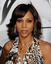 Holly Robinson Peete attended the premiere of '21 Jump Street' wearing her layered cut in a subtly feathered 'do.