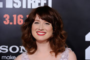Ellie Kemper arrived at the premiere of '21 Jump Street' wearing her shiny tresses in voluminous waves with brow-length bangs.