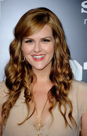 Sara Rue arrived at the premiere of '21 Jump Street' wearing her long hair in flowing waves with side-swept bangs.