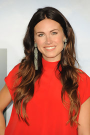 Vail Bloom paired her red frock with silver chain embellished earrings.