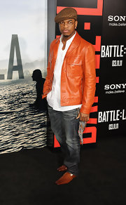 Ne-Yo attended the premiere of 'Battle: Los Angeles' sporting a bright orange leather jacket.