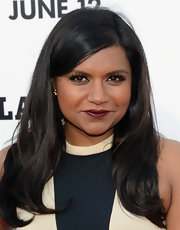 Mindy Kaling's raven tresses looked sleek and shiny when styled into a side-parted 'do with a slight wave at the ends.
