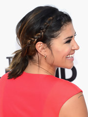 Jessica Szohr showed off her caramel highlights with a pulled back messy ponytail that featured a cool side braid.