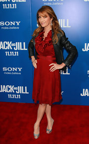 Jane Seymour added spice to her ruffled red dress with the unexpected addition of a black leather jacket.