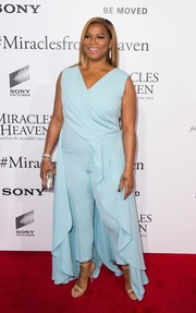 Queen Latifah opted for simple styling with a pair of nude ankle-strap heels.