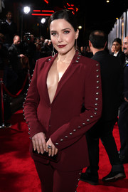 Sophia Bush teamed a maroon box clutch with a studded pantsuit for the premiere of 'Miss Bala.'