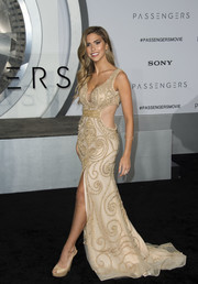 Kara Del Toro stole the spotlight in a beaded nude gown with a plunging neckline, side cutouts, and a high front slit during the premiere of 'Passengers.'