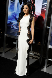 Aimee Garcia looked breathtaking at the 'Robocop' premiere in a white Lorena Sarbu column dress with black lace panels down both sides.