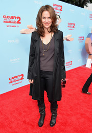 Amy Brenneman channeled the movie 'Matrix' with her black mid-calf boots and coat combo during the premiere of 'Cloudy with a Chance of Meatballs 2.'