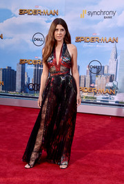 Marisa Tomei went the sultry route in a partially sheer lace-panel halter gown by Zuhair Murad at the premiere of 'Spider-Man: Homecoming.'