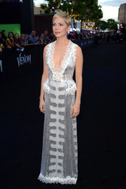 Michelle Williams was a shimmering beauty in a lace-trimmed sequin gown by Louis Vuitton at the premiere of 'Venom.'