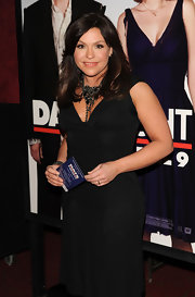 Rachael Ray glams up her black dress with a black beaded statement necklace.