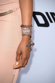 Erica Ash brought out the bling with this beaded bracelet, featuring a beaded cross charm.