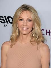 To add just a touch of shine to her dewy, glowing look, Heather Locklear swiped on some clear gloss.