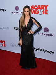 Ashley Tisdale simply stunned in a black sequined gown that featured a plunging neck, illusion paneling and a full fit-and-flare skirt.