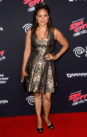 Tracie Thoms went for high shine in a metallic gold cocktail dress during the 'Sin City: A Dame to Kill For' premiere.