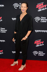Michelle Wie looked cool on the red carpet in a black jumpsuit with studded shoulders during the 'Sin City: A Dame to Kill For' premiere.
