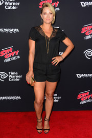 Zoe Bell added some elegant shine to her casual look with a metallic gold clutch.