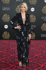 Jenna Elfman showed some cleavage in a floral maxi dress with a navel-grazing lace-up neckline during the premiere of 'Alice Through the Looking Glass.'