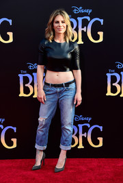 Jillian Michaels continued the edgy vibe with a pair of ripped boyfriend jeans.