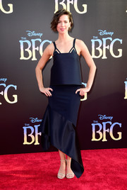 Rebecca Hall completed her outfit with an asymmetrical, fluted-hem navy skirt, also by Dion Lee.