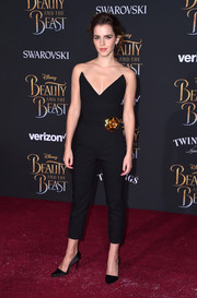 Emma Watson went for relaxed glamour in a strapless V-neck jumpsuit by Oscar de la Renta adorned with a 24kt gold gardenia brooch during the premiere of 'Beauty and the Beast.'
