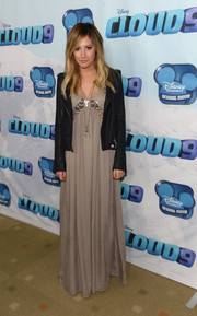 Ashley Tisdale chose a flowy gray Blesse'd are the Meek maxi dress with crochet detailing for the premiere of 'Cloud 9.'