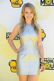 Bridgit Mendler shimmered in a futuristic silver sheath dress.