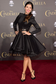 Ali Landry cut a bold silhouette in a little black dress with padded shoulders and a super-flared skirt during the Hollywood premiere of 'Cinderella.'