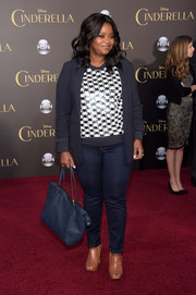 Octavia Spencer chose a simple blue leather tote to top off her look.