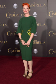 Sandy Powell attended the Hollywood premiere of 'Cinderella' wearing a gold-accented green dress, which contrasted beautifully with her orange hair.