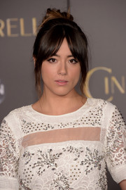 Chloe Bennet sported a messy hair knot with parted bangs at the Hollywood premiere of 'Cinderella.'