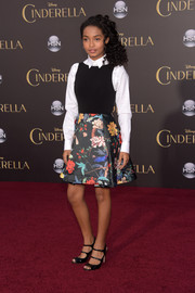 Yara Shahidi attended the 'Cinderella' premiere looking preppy in a cute dress with a black bodice and a floral skirt, which she wore with a collared shirt underneath.