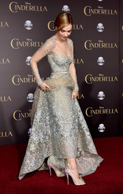 Lily James showed off her 'glass slippers' at the 'Cinderella' premiere, a heavily embellished pair of nude peep-toe pumps by Christian Louboutin.