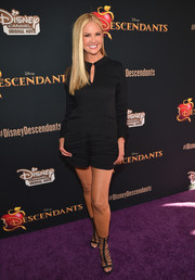 Nancy O'Dell kept it youthful and cool in a black romper during the 'Descendants' premiere.