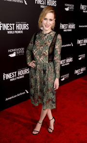Rachel Brosnahan completed her red carpet ensemble with a pair of black ankle-strap sandals.
