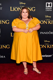 Chrissy Metz brightened up the red carpet with this mustard off-the-shoulder dress at the premiere of 'The Lion King.'