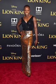 Florence Kasumba glitzed up in a two-tone sequined and beaded gown by Jenny Packham for the premiere of 'The Lion King.'