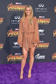 Gwyneth Paltrow showed off her fabulous pins in a beaded coral mini dress by Retrofête at the premiere of 'Avengers: Infinity War.'
