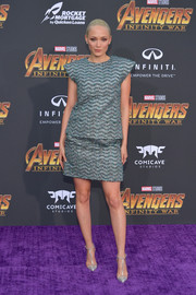 Pom Klementieff continued the metallic theme with a pair of silver T-strap pumps.