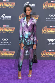 Letitia Wright looked flamboyant in a printed pantsuit by Prada at the premiere of 'Avengers: Infinity War.' The tulle overskirt added a whimsical touch.