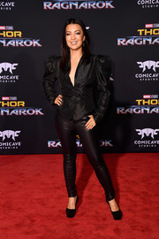 Ming-Na Wen completed her edgy-chic outfit with black leather leggings.