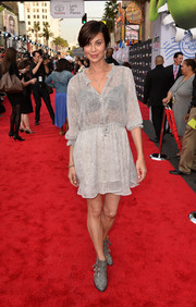 Catherine Bell contrasted her girly dress with a pair of edgy gray ankle boots.