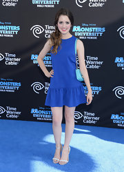 Laura Marano chose a bright blue drop-waist dress with a flared skirt for her look at the 'Monster University' premiere.
