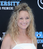 Teri pulled back her natural beach waves into a half up 'do.